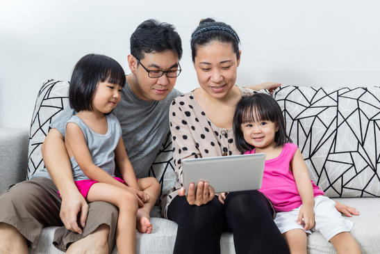Happy Asian Chinese Family Playing with Digital Tablet Together